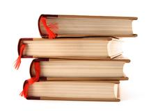 Books with bookmarks on white background - stock photo