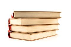 Four hardcover books on white background - stock photo