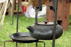 Antique cast-iron kettle - stock photo