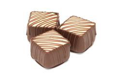 Chocolate pralines on white background Stock Photos