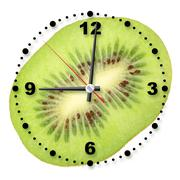 single cross section of kiwi as a office clock - stock photo