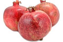 ripe pomegranates isolated on white background - stock photo
