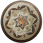 Stock Photo of Isolated  turkish copper engraved plate on a white background