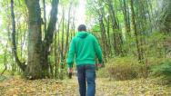 Stock Video Footage of Man in Green Forest Walking Away