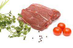 Piece of beef and vegetables on white Stock Photos