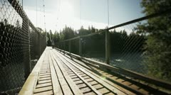 Young Adult Walking on a Hanging Bridge HD - stock footage