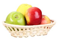 four apples in basket - stock photo