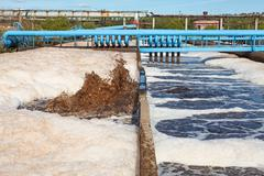 removing physical, chemical and biological contaminants on sewage treatment - stock photo