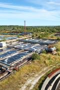 Stock Photo of industrial water treatment plant in evergreen forests