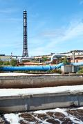 water treatment plant view with chimney and blue sky - stock photo