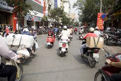 Saigon in Vietnam. Vietnamese culture,people,city life, motorbikes. Stock Photos