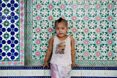 Stock Photo of Saigon in Vietnam. Vietnamese culture,buddhist kid,temple.