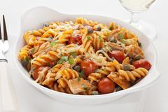 Pasta bake with tuna and tomatoes Stock Photos