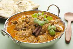 indian meal food curry lamb rogan josh naan bread - stock photo