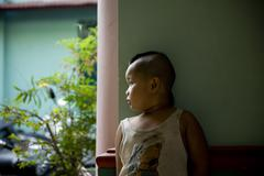 Saigon in Vietnam. Vietnamese culture,buddhist kid,temple, motorbikes. Stock Photos