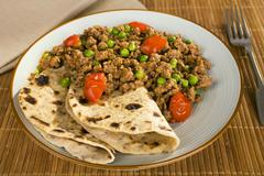 lamb keema curry with peas and chapati - stock photo