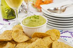 guacamole with corn chips celebration - stock photo