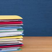 stack of files on wood surface square - stock photo