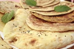 Indian bread selection nan roti curry Stock Photos