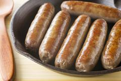 Sausages in an iron skillet Stock Photos