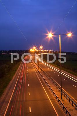 Stock photo of road and traffic at night