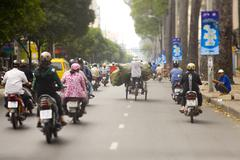 Stock Photo of Saigon in Vietnam. Vietnamese culture,people,city life, motorbikes.