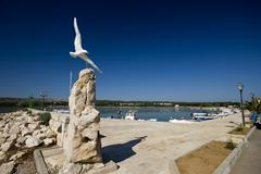 Sculpture of the sea gull flying in Posedarje - stock photo