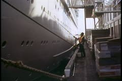 Ship, Ocean liner, Island Princess, The Love Boat, workman painting the hull Stock Footage