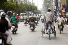Saigon in Vietnam. Vietnamese culture,people,city life, motorbikes. - stock photo