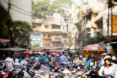 Saigon in Vietnam. Vietnamese culture,people,city life, motorbikes. - stock photo