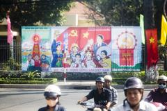 Saigon in Vietnam. Vietnamese culture,communism,people,city life, motorbikes. - stock photo