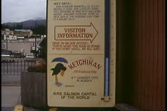 Ketchikan, Alaska, rain gauge, tilt up, wettest city in the world Stock Footage