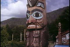 Totem pole, at Ketchikan, Alaska, Alaska Cruise sight, wide shot Stock Footage