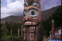 Totem pole, at Ketchikan, Alaska, Alaska Cruise sight, wide shot Stock Footage