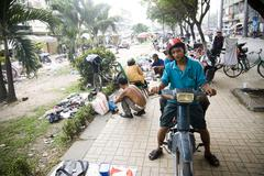 Saigon in Vietnam. Vietnamese culture,people,market, motorbikes. Stock Photos