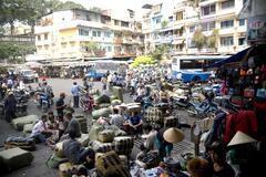 Saigon in Vietnam. Vietnamese culture,market,people,city life, motorbikes. - stock photo