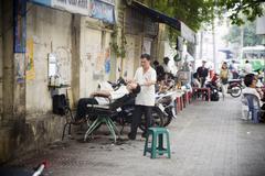 Saigon in Vietnam. Vietnamese culture,hairdresser,city life, motorbikes. - stock photo