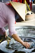 Saigon in Vietnam. Vietnamese culture,people,market, city life, motorbikes. - stock photo