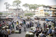 Stock Photo of Saigon in Vietnam. Vietnamese culture,market,people,city life, motorbikes.