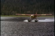 Misty Fjord, air flight, takeoff float plane from lake, Alaska, Inside Passage Stock Footage