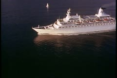 Aerial shot of cruise ship, The Love Boat, sailing in Alaska, Inside Passage Stock Footage