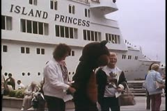 Cruise ship passengers in Juneau Alaska greeted by Smiling Bear mascot Stock Footage