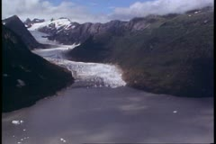 POV aerial, helicopter, Alaska, approaching cove and glacier face Stock Footage