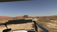 Drive in safari truck - stock footage