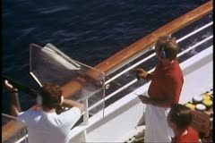 Skeet shooting, close up zoom back wide, off the deck of a cruise ship Stock Footage