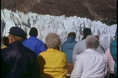 Crowd watches from decks, Alaska Cruise, snowy mountains Stock Footage