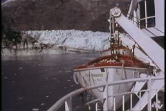 Ship sails away, lifeboats on side, glaciers retreats, Alaska, Inside Passage Stock Footage