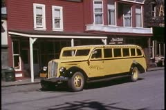 Skagway, Alaska, Main Street, old yellow touring coach Stock Footage
