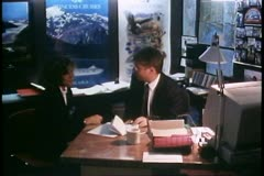 Shore excursion manager with customer at his desk on a cruise ship Stock Footage