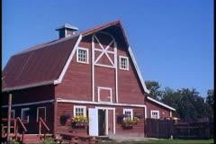 Matanuska Valley, Alaska, barn, red, wide shot, pan right Stock Footage